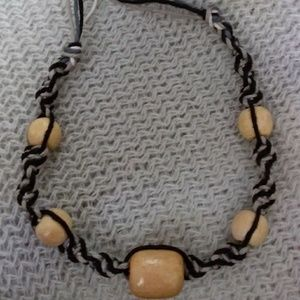 Braided hemp cord bracelet with wooden beads